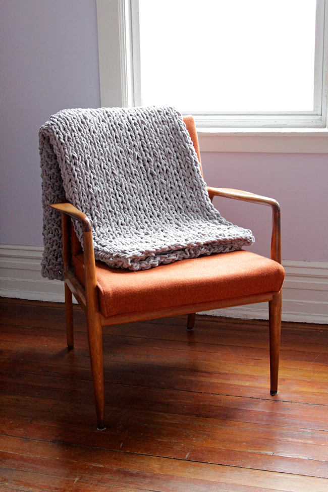 hands-occupied-knit-rug-throw-5
