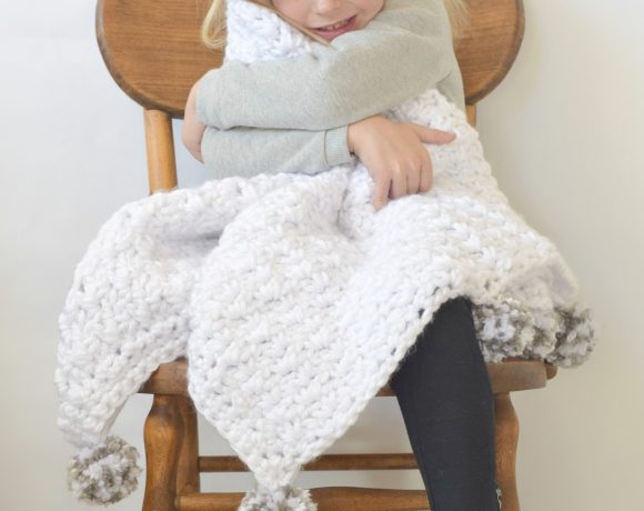 """The Loft"" Pom Baby Blanket"